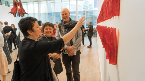 Sonya Kelliher-Coombs and audience in front of her work «Red Curl» at the preview of «Subsistence»